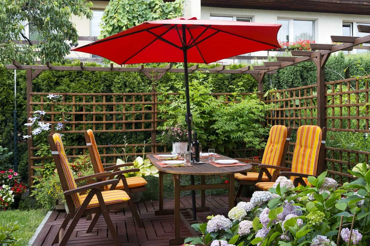 Image of umbrella in garden to illustrate how to replace a patio umbrella cord